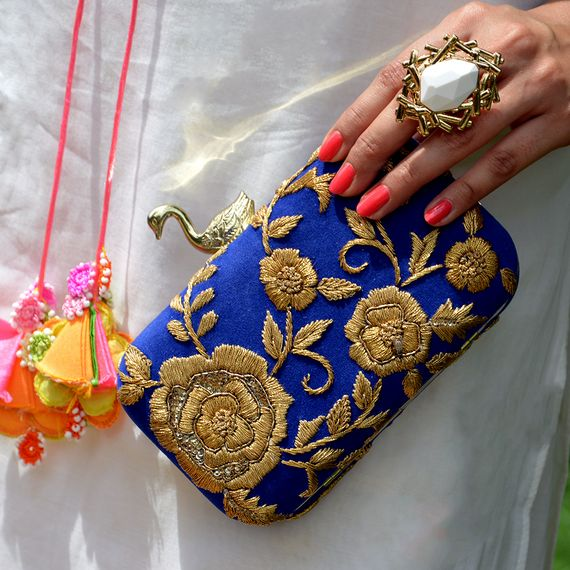 Photo of blue and gold clutch