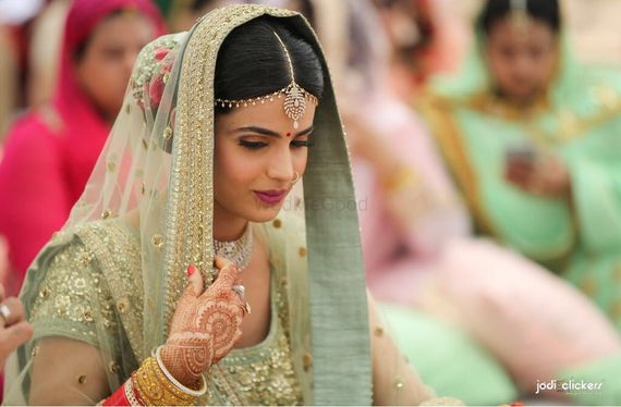 Photo of Offbeat seafoam sikh bridal lehenga