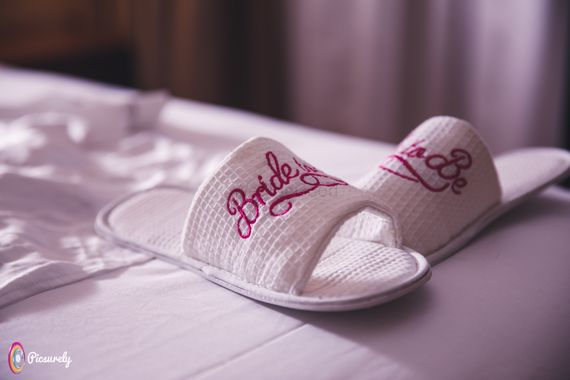 Photo of Customised bridal slippers with bride written