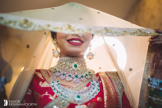 Photo of diamond and emerald choker necklace for south indian bride