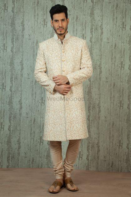 Photo of cream and white sherwani