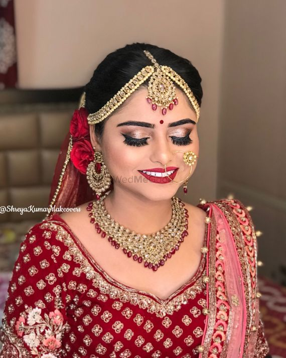 Photo of Red bridal lehenga with beautiful bridal makeup