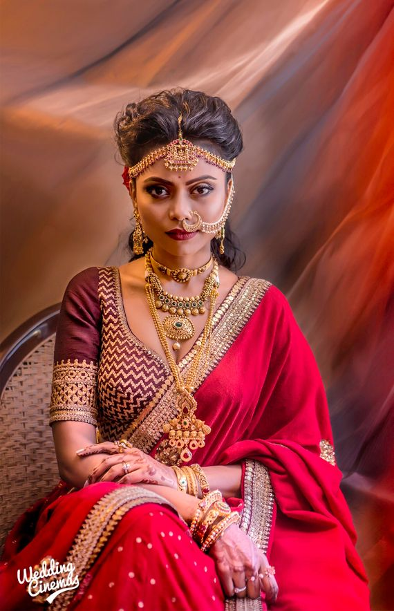 Photo Of Unique Bridal Portrait With Layered Gold Jewellery