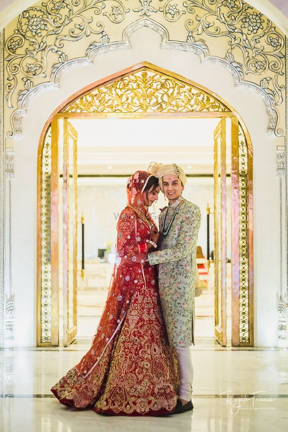 Photo of Bride and groom in contrasting embroidered outfits
