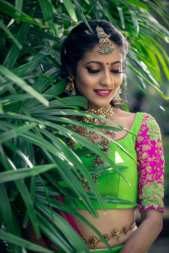 Photo of Bride in green and pink lehenga with embroidered sleeves