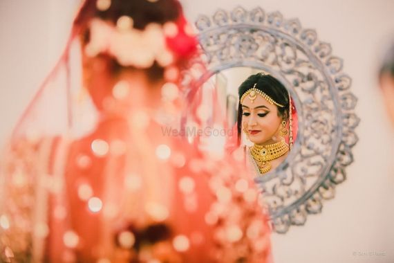 Photo of Bridal portrait idea with looking into framed mirror