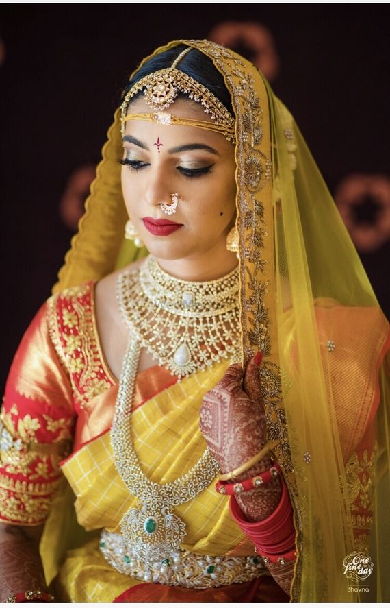 Photo of South Indian layered bridal jewellery with diamonds and emeralds