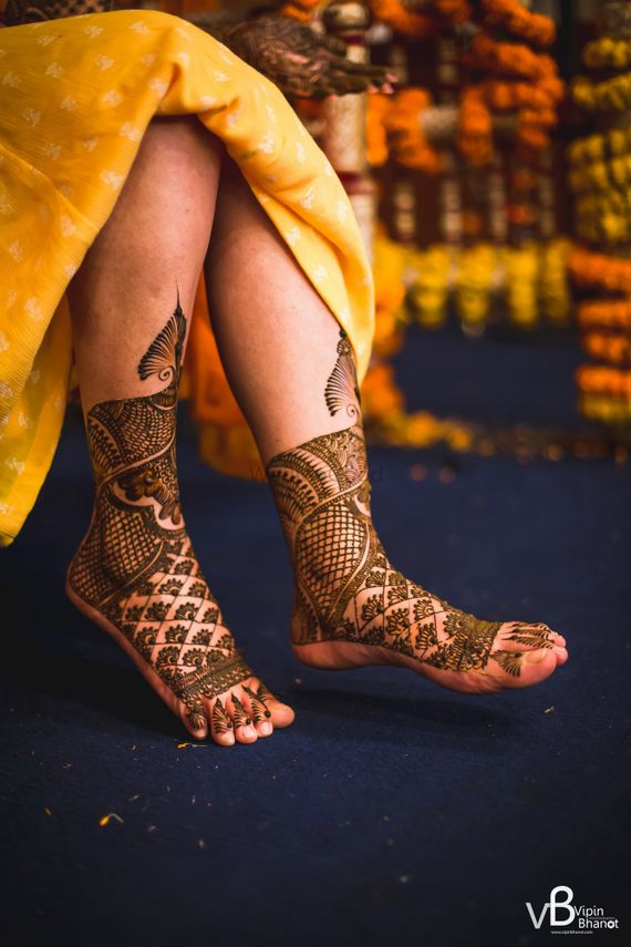 Photo of A bride with mehendi on her feet