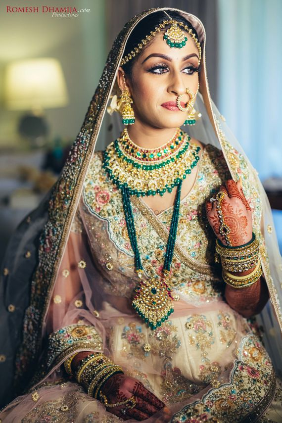 Photo of Sabyasachi bride with layered contrasting jewellery