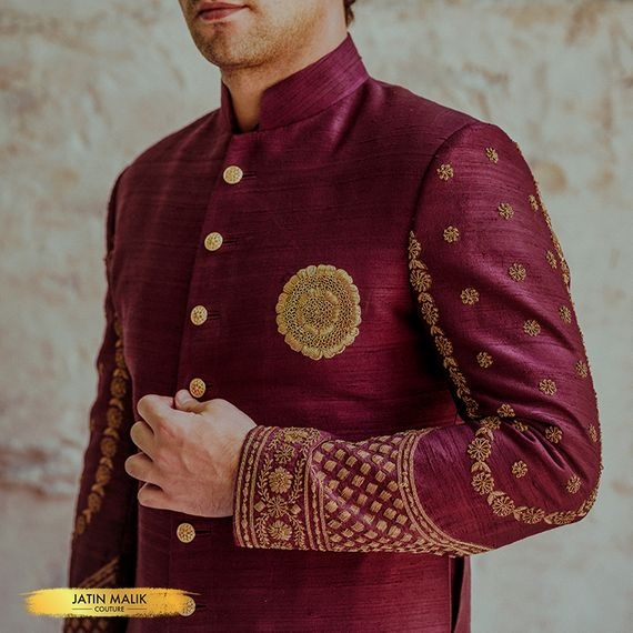 Photo of Unique groomwear outfit with embroidered sherwani brooch