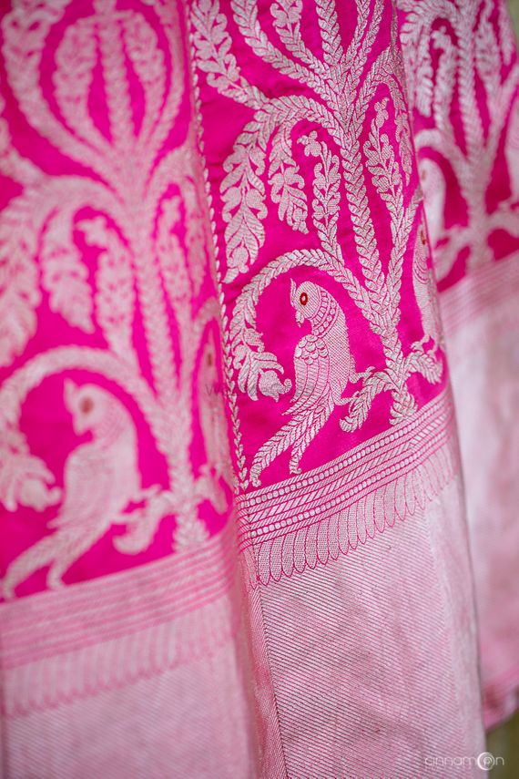 Photo of Bright pink benarasi lehenga with parrot motifs