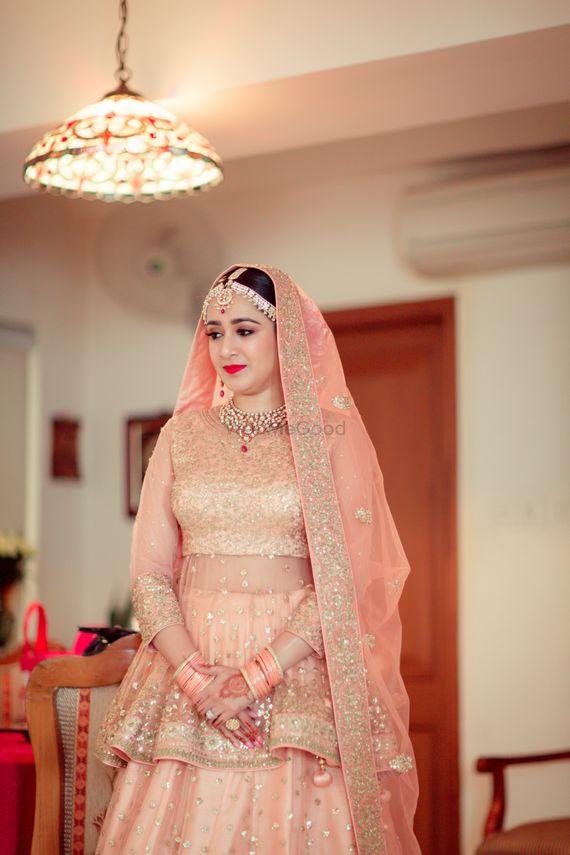 Photo of Peach bridal lehenga with peplum blouse design