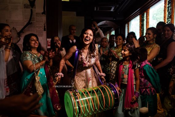 Photo of Happy bride shot playing dhol