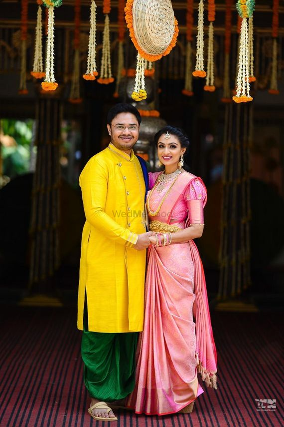 Photo of south indian bride and groom in contrasting outfits