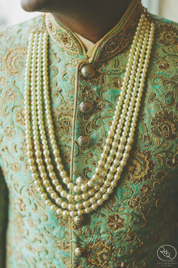 Photo of Pearl groom necklace with mint green sherwani