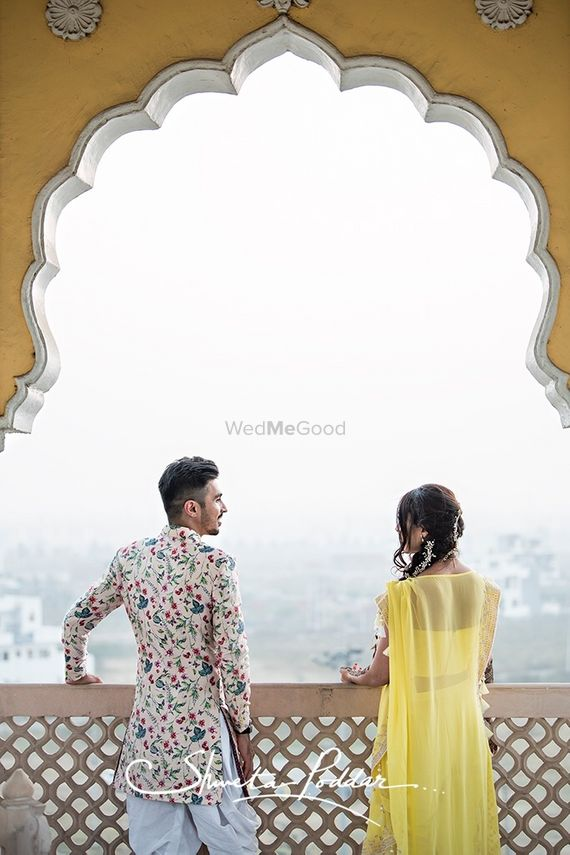 Photo of Fort pre wedding shoot with groom in floral sherwani