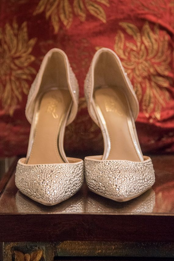 Photo of Gold bridal heels with stones