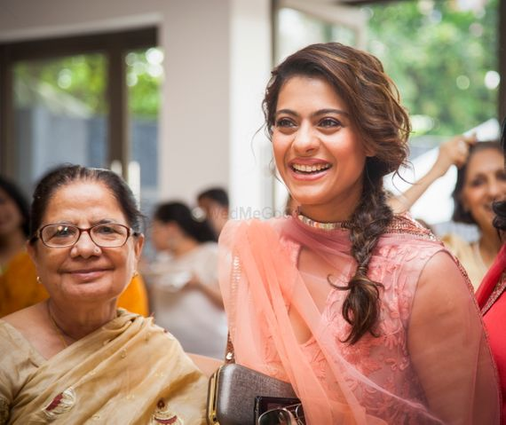Photo of Kajol at wedding with side braid
