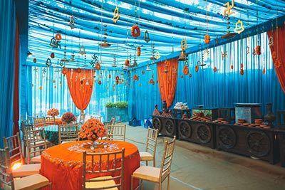 Photo of Mehendi decor idea with orange and blue decor