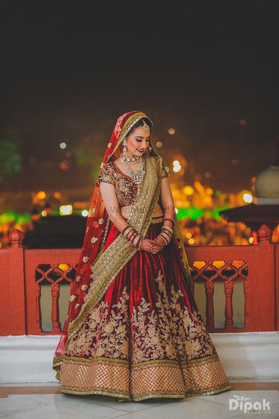 Photo of maroon velvet bridal lehenga