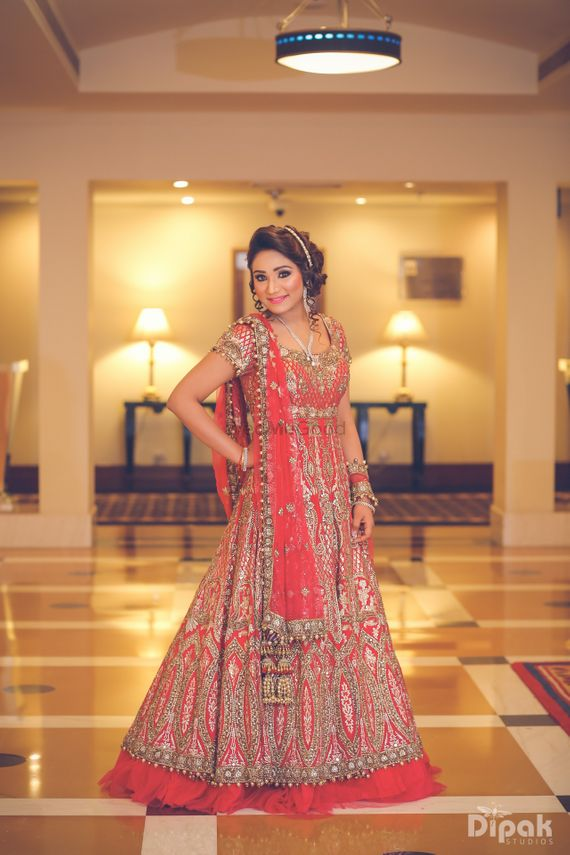 Photo of layered orange anarkali lehenga