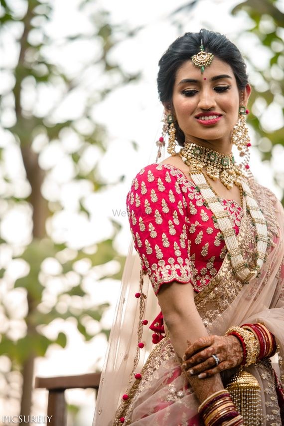 Photo of Red and dusty pink lehenga