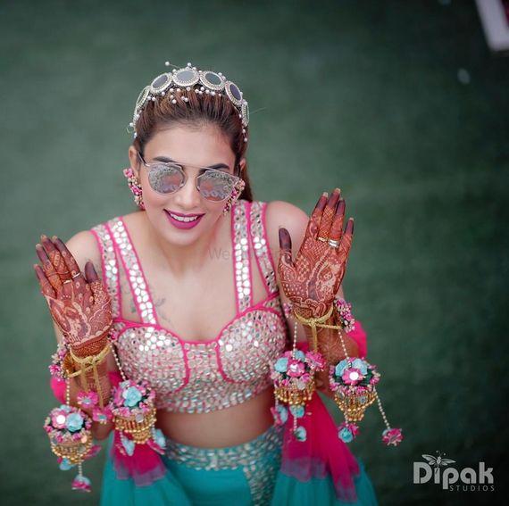 Photo of Bride on mehendi wearing floral kaleere