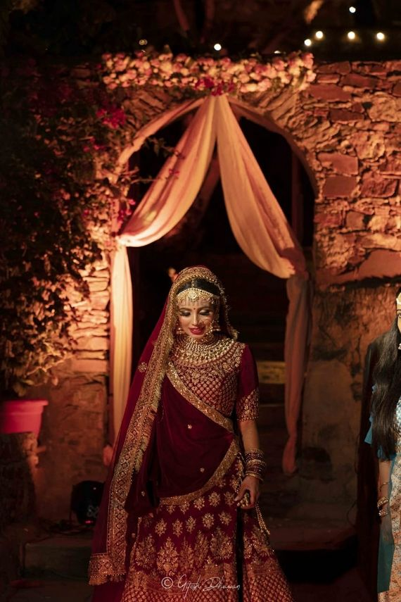 Photo of gorgeous bridal portrait with the bride in stunning makeup