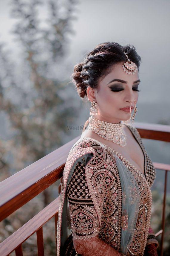 Photo of Bride with smokey eyes and offbeat lehenga
