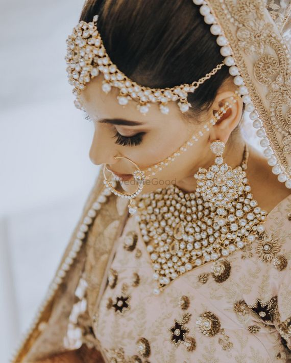 Photo of Bridal jewellery with beige lehenga and bib necklace