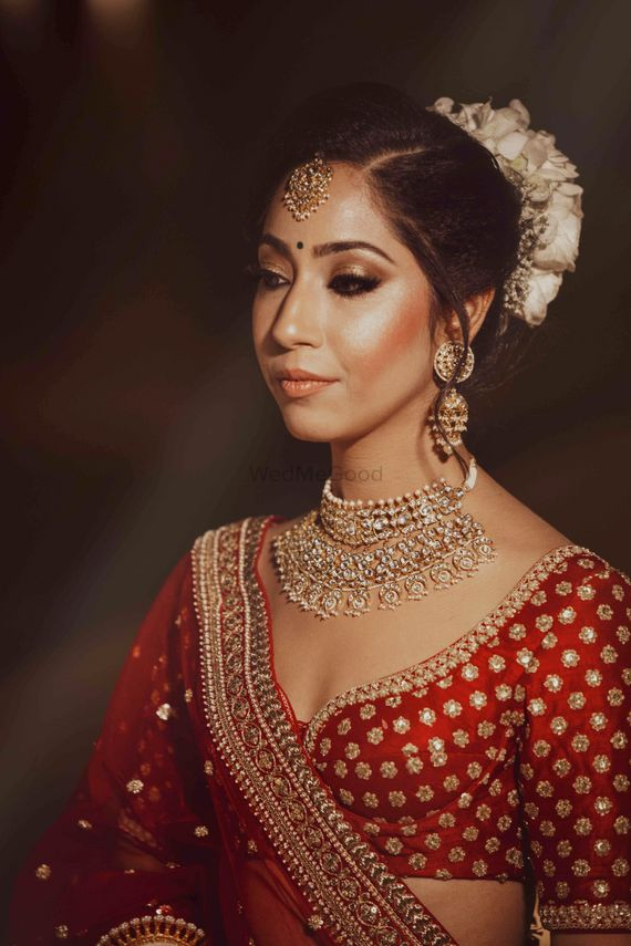 Photo of Bride with choli cut blouse and nude makeup