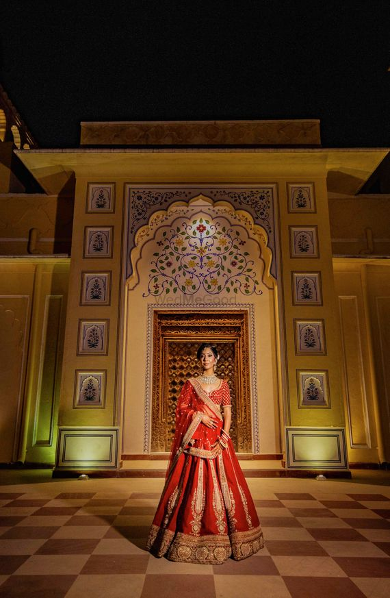 Photo of Red and gold bridal lehenga bridal portrait