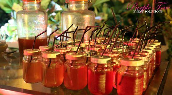 Photo of Mason jar drinks at wedding
