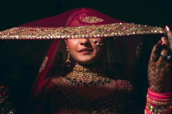Photo of Bride under a veil