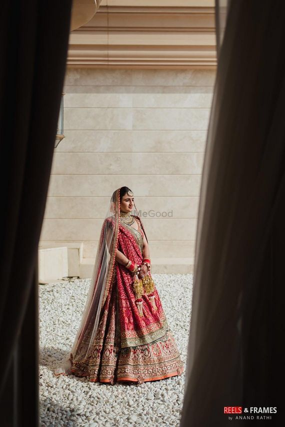 Photo of red and gold bridal lehenga with lots of embroidery