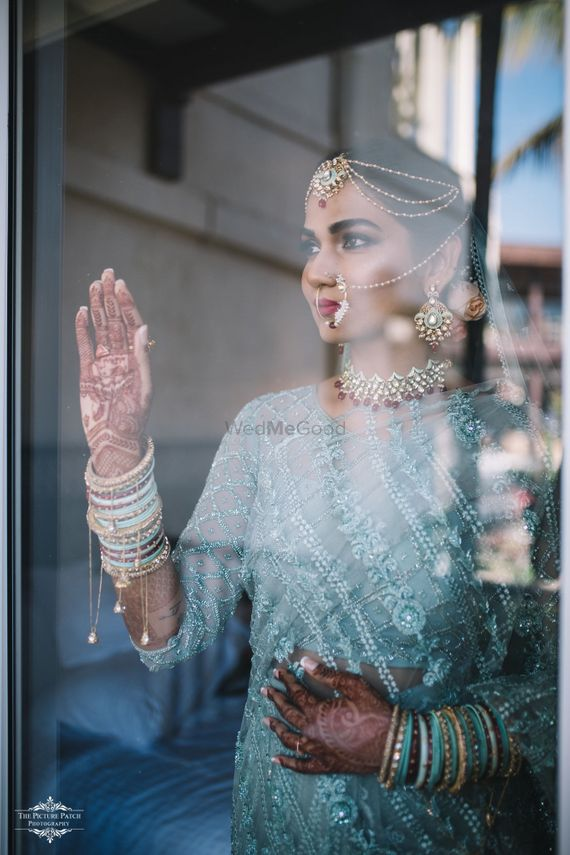 Photo of A unique bridal portrait, with a bride wearing an off-beat outfit!