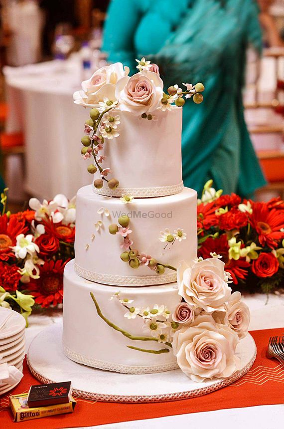 Photo Of 3 Layer Wedding Cake With Floral Decor