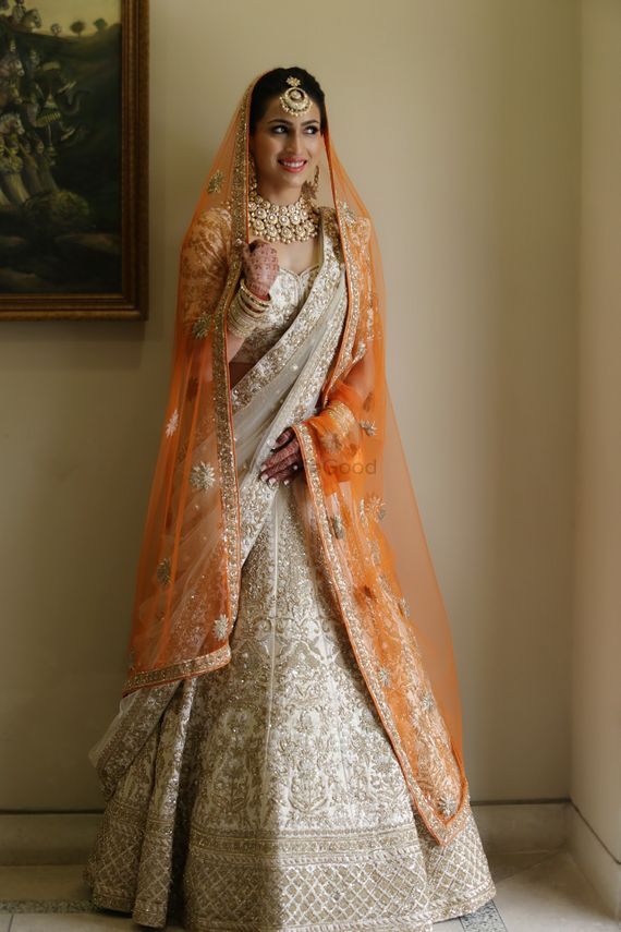 Photo of A bride in a uniquely colored bridal lehenga with a double dupatta