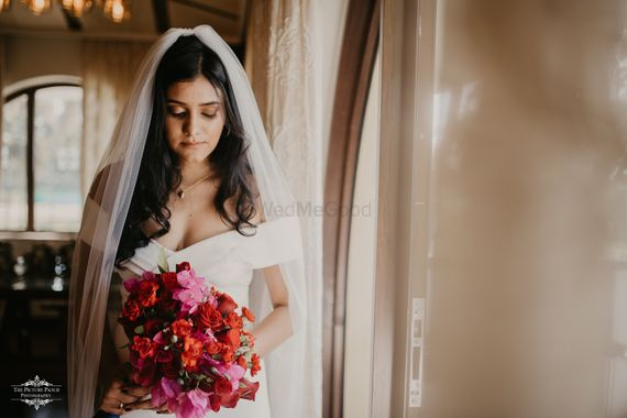 Photo of Christian wedding bride holding a red bouquet