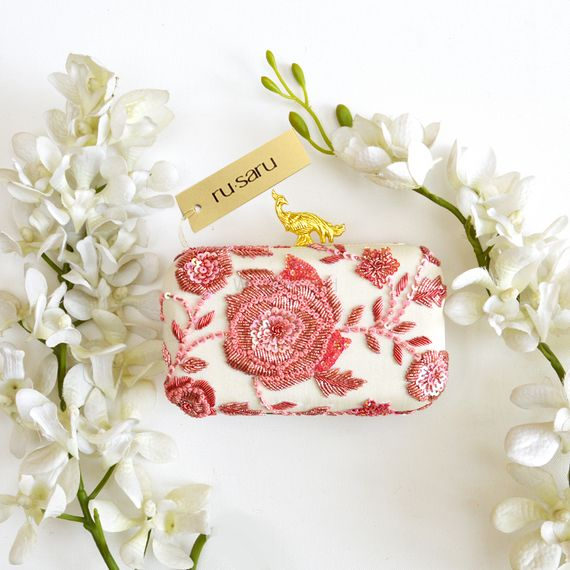 Photo of White and pink  box clutch for brides