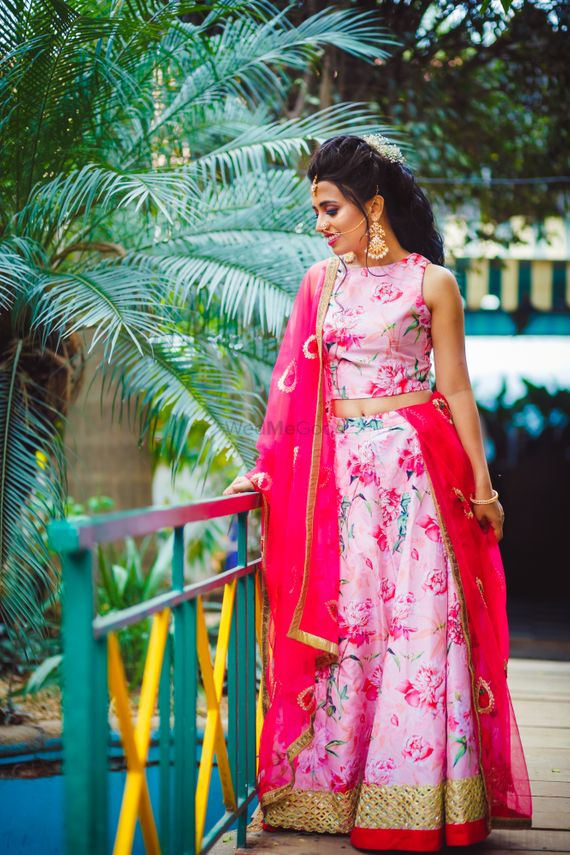 Photo of floral printed pink lehenga for engagement at home
