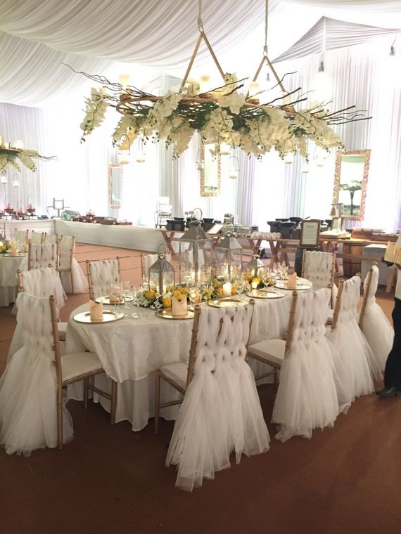 Photo of White Ruffles and Floral Themed Decor