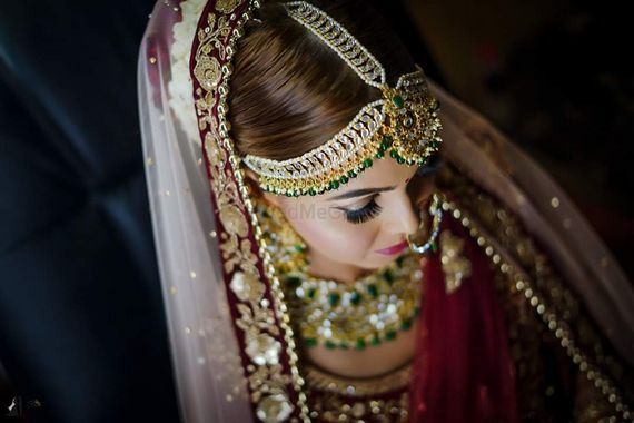 Photo of Heavy bridal mathapatti with green and kundan