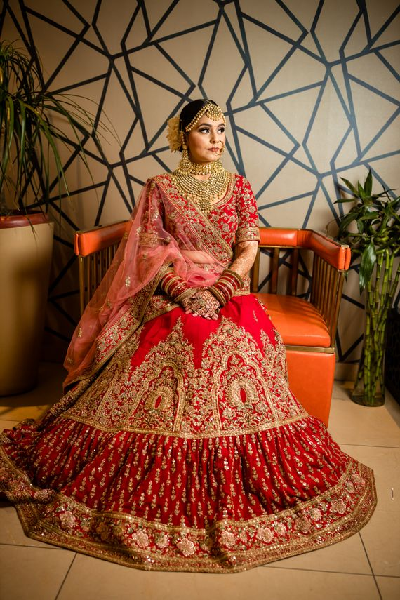 Photo of Red lehenga with unique layered border