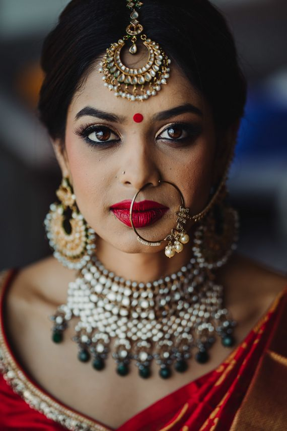 Photo of South indian fusion bridal look wearing nath