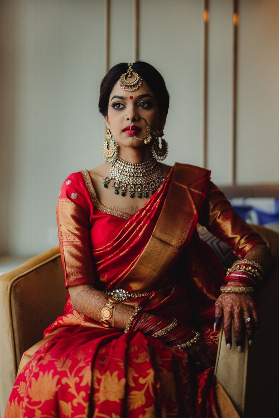 Photo of South indian bridal look in red kanjivaram and green jewellery