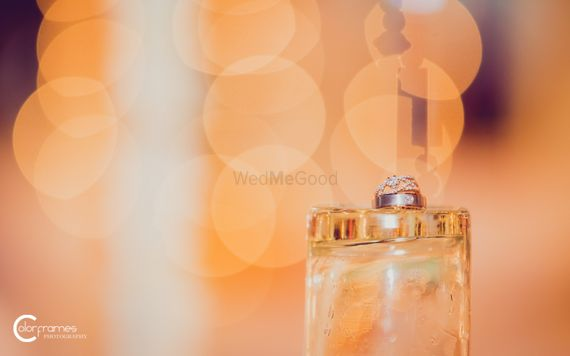 Photo of Engagement Rings on Inverted Glass