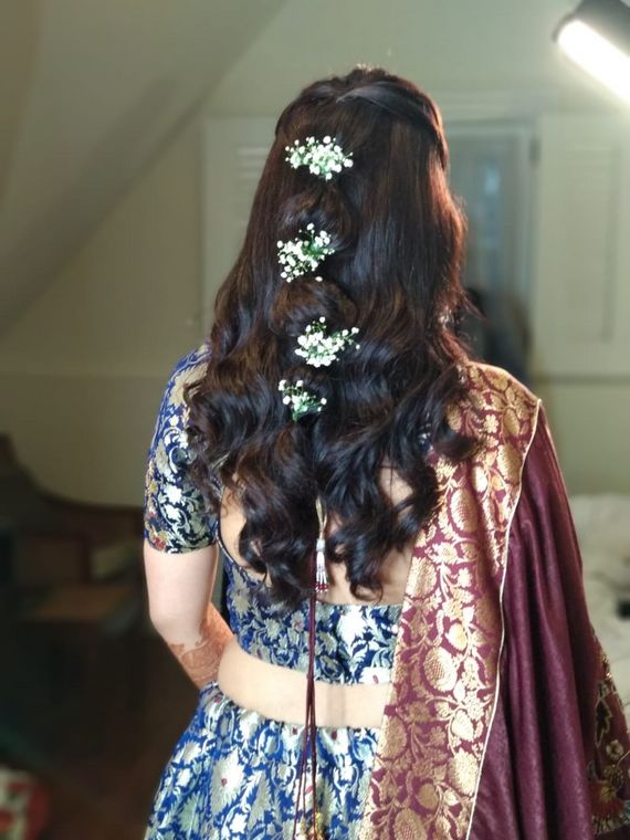 Photo of A bride flaunting her soft curls with hair