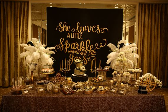 Photo of Gold Themed Table Decor with Blackboard Decor