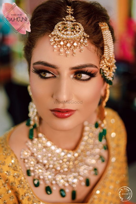 Photo of A stunning bride in a subtle makeup.